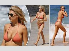Charlotte McKinney squeezes her ample assets into tiny
