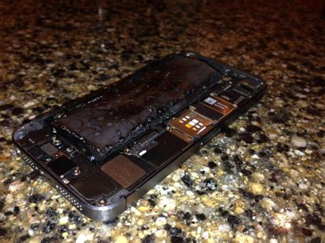 exploding iphone battery this is what an iphone 5s looks like when its battery 3506