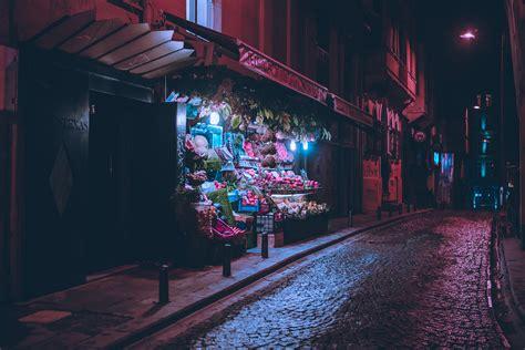 nighttime city scenes bathed  neon  photographer elsa