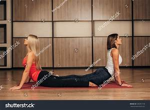 Two Young Women In The Pose Of A Cobra Stock Photo ...
