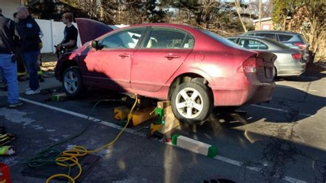 cat rescued cars engine wedge