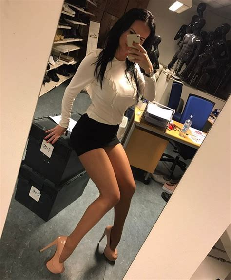 I  her tight mini skirt and high heels  she has long sexy