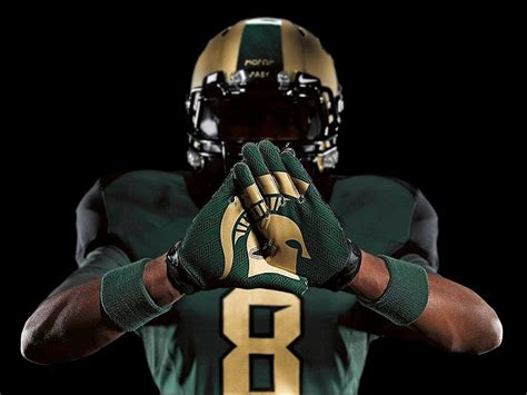 michigan state university football reveals  uniforms