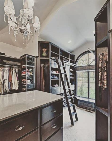 picture of gorgeous big walk in closet with lots of storage