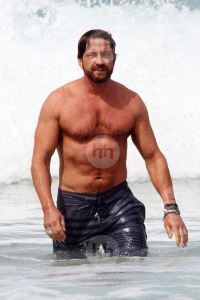 gerard butler shows   muscles  sydneys bondi