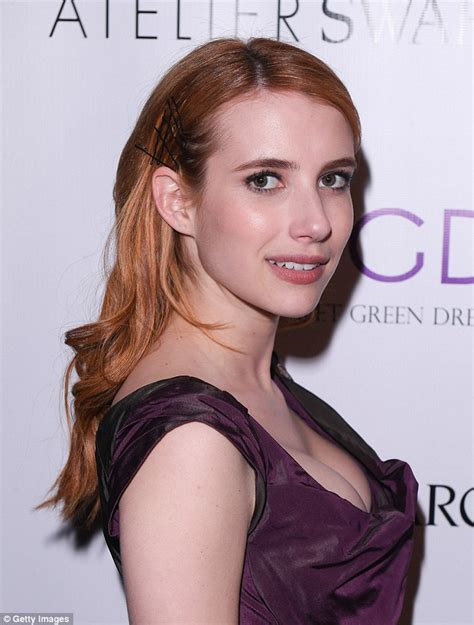 Emma Roberts puts on a busty display in a quirky dress ...