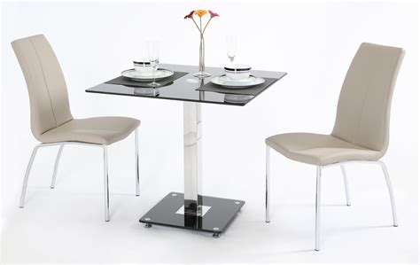 black glass dining table and 2 mink grey chairs homegenies