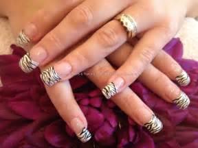 Acrylic nails with zebra print as nail art nailart
