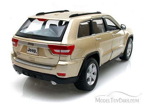 jeep cherokee toy jeep grand cherokee laredo gold maisto 34205 1 24