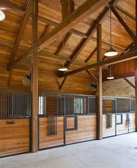 i like the overhead lighting horse barn lighting ideas
