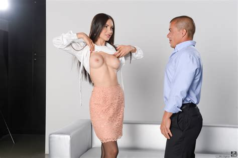 Smartly dressed Sasha Rose flashes her boobs before screwing in her black nylons and stiletto heels