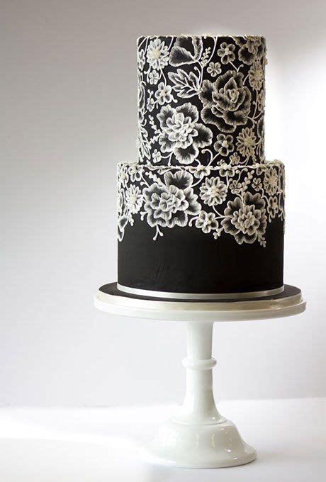 elegant white cake  gold piping cakes black