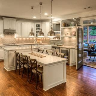 kitchen island with table extension atlanta homes by luxury home builders ashton