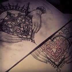 Hand Holding Heart Tattoo Designs