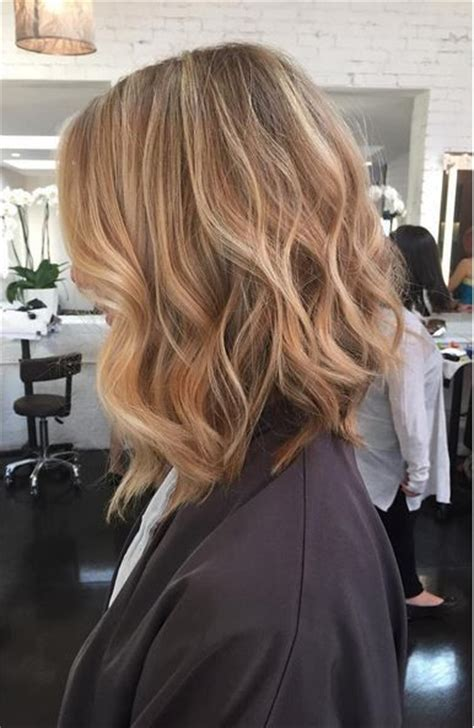 wheat blonde highlights  textured long bob hairstyle