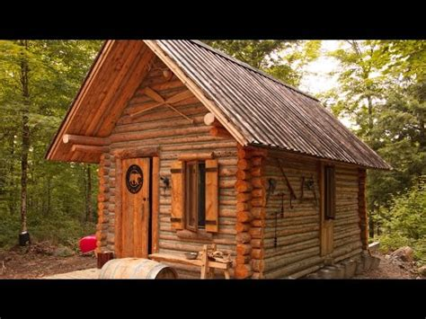 time lapse video   man building  log cabin  scratch