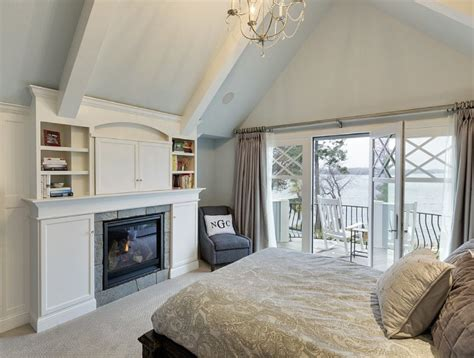 Bedroom Above Fireplace by Inspiring Lake House Interiors Home Bunch Interior