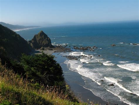 Scenic Oregon coast on a summer's day. The frigid water te ...