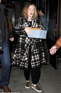 baby boy album adele drops wrapped gift as she steps out of tribeca