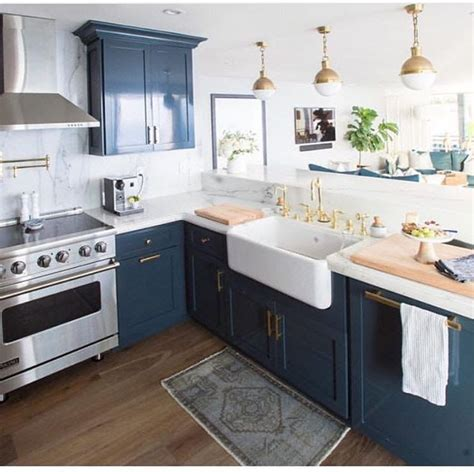 navy blue cabinets  gold accents kitchens