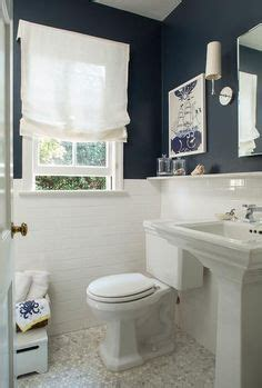 white  navy cottage bathroom features upper walls