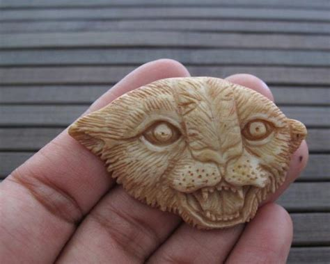 stunning detail hand carved cougar buffalo bone carving