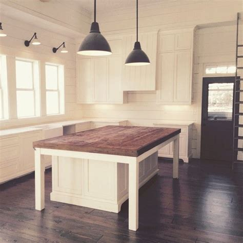 table island kitchen i love the white with the dark island flooring and door that light fixture is perf
