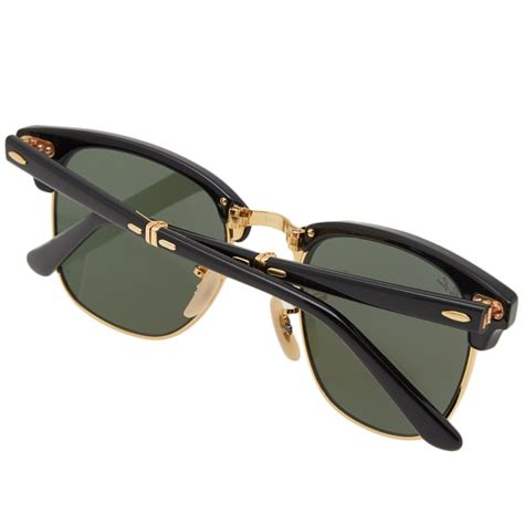 Put the pedal to the metal to discover these standout shades. Ray Ban Clubmaster Folding Sunglasses (Black & Green) | END.