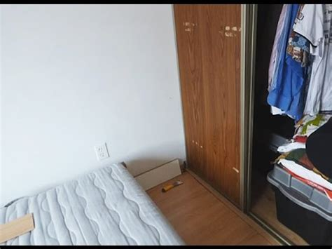 how to remove sliding closet door from bottom track