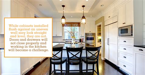 how to install kitchen cabinets with uneven ceiling can i install cabinets with an uneven floor or