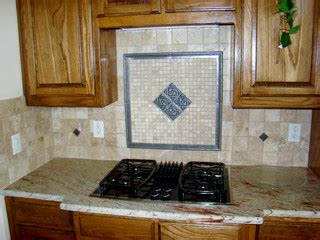 kitchen cabinets and backsplash travertine backsplash with pewter inserts mediterranean 5893