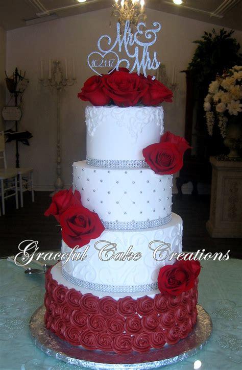 elegant white butter cream wedding cake  burgundy rose