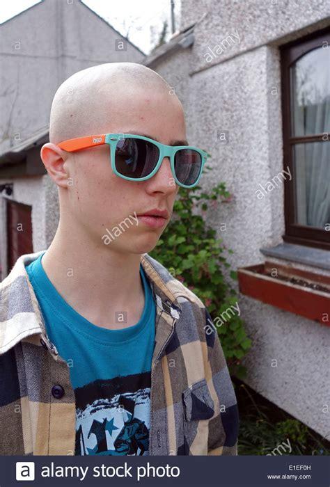 teenage boy   skinhead haircut stock photo