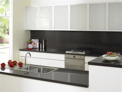Black Cupboards Kitchen Ideas by Black Bench Top And Splash With Frosted Overhead Cupboards
