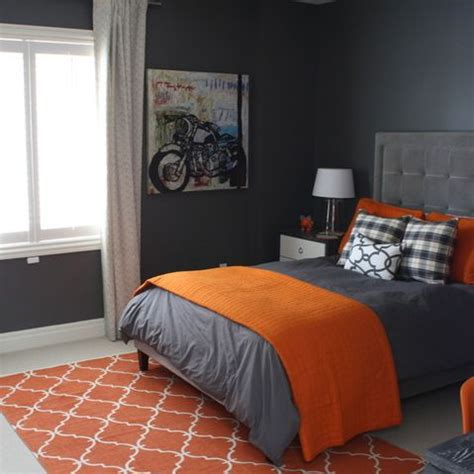 stylish orange and dark gray bedding to cover gray painted