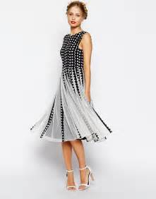 midi dresses for wedding guest asos asos spot mesh insert fit and flare midi dress at asos
