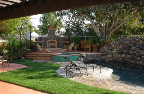 exterior pool side style fireplace homebuilding