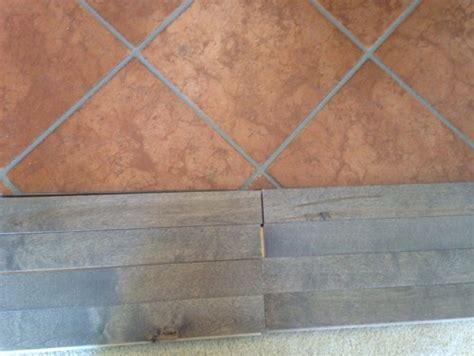 Wood floor adjoining terra cotta tile floor