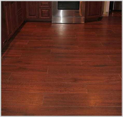 wood floor vs ceramic tile in kitchen tiles home