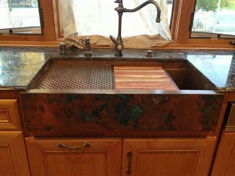 copper sink  black countertop kitchen sink