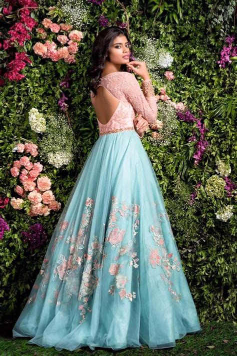 blush pink  blue gown  thread work  hints