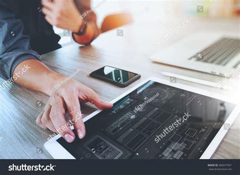 website designer working digital tablet computer stock