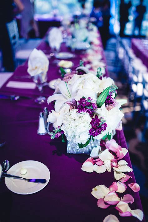 Purple themed table setting Reception flowers Table