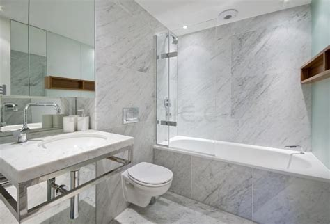 modern master bathroom with tiled wall showerbath by
