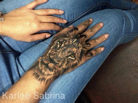 stunning lion hand tattoo  tattoo design ideas