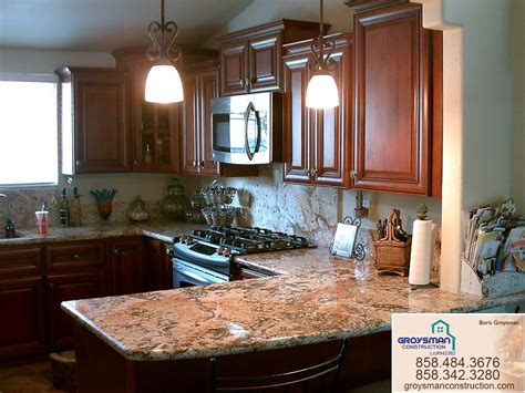cherry cabinets  granite countertopzeus remodeling