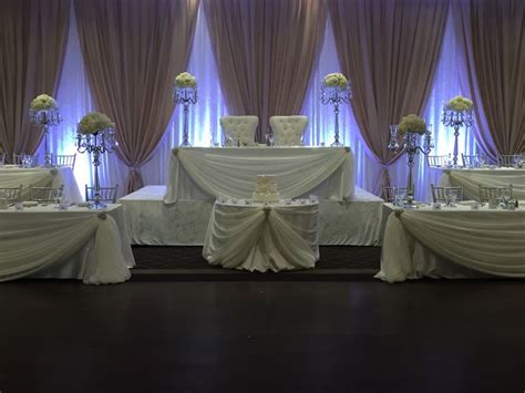 chagne and ivory backdrop 5 tier head table made for large bridal party backdrops
