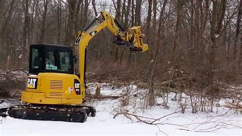darrell curtis cat  excavator  tree shear january   youtube