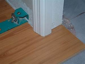 Under cutting door jambs with a hand saw before for How to lay down laminate flooring