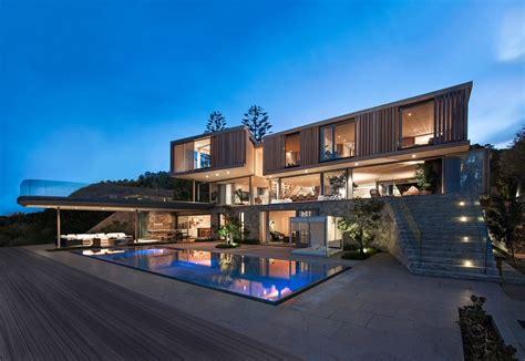 wooden facade modern house design  saota architecture beast